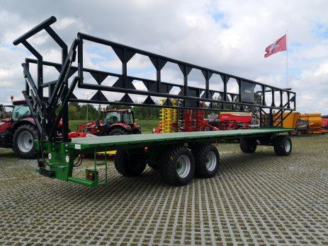 Rulonai transportuojami ypač saugiai su hidrauliniais platformos bortais